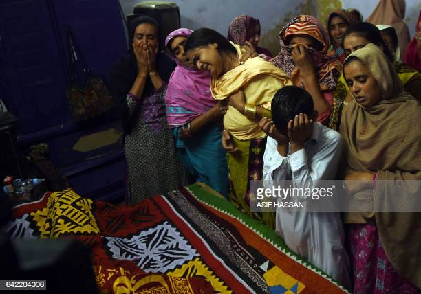 Pakistani relatives mourn over the coffin of a 13yearold blast victim Zeeshan during his funeral in the town of Sehwan in Sindh province some 200...