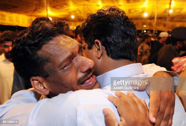 Pakistani relatives mourn over the victims of the deadly ambush on the Sri Lankan cricket team prior to their burial in Lahore on March 3 2009...