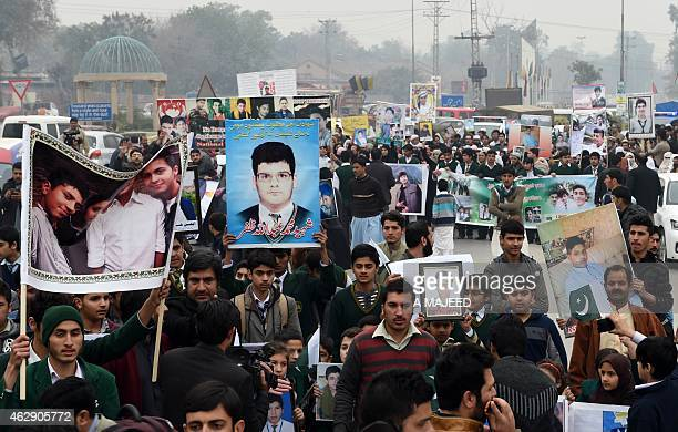 Pakistani relatives of schoolchildren killed in a Taliban attack on the Army Public School protest against delays in the investigation in Peshawar on...