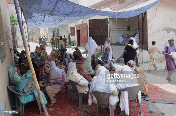 Pakistani relatives of two blast victims police brothers Ali Raza and Ghulam Murtaza who were martyred in a deadly suicide blast on the Ferozepur...