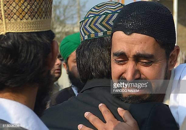 Pakistani relatives react following the execution of convicted murderer Mumtaz Qadri in Rawalpindi on February 29, 2016. Pakistan on February 29...