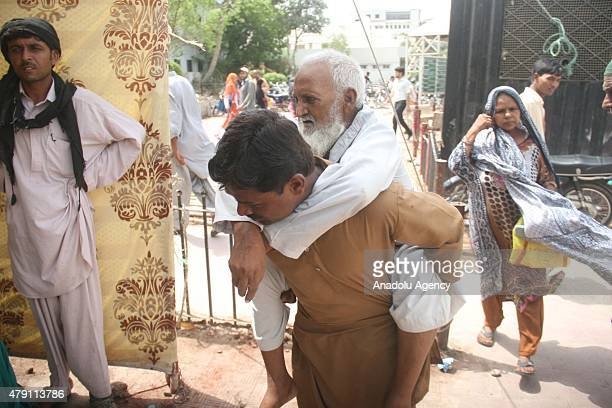 Pakistani relatives shift a heatstroke victim to a government hospital in Karachi Pakistan July 01 2015 Nearly twothirds of the victims of a killer...