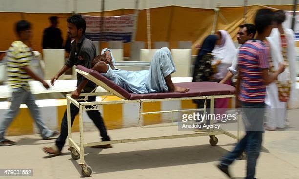 Pakistani relatives shift a heatstroke victim to a hospital in Karachi Pakistan June 30 2015 A Pakistani official says the devastating weeklong...
