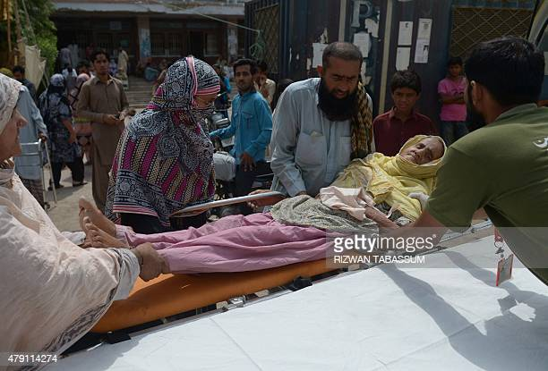 Pakistani relatives shift a heatstroke victim to a hospital in Karachi on July 1 2015 More than 1200 people have died as a result of days of...