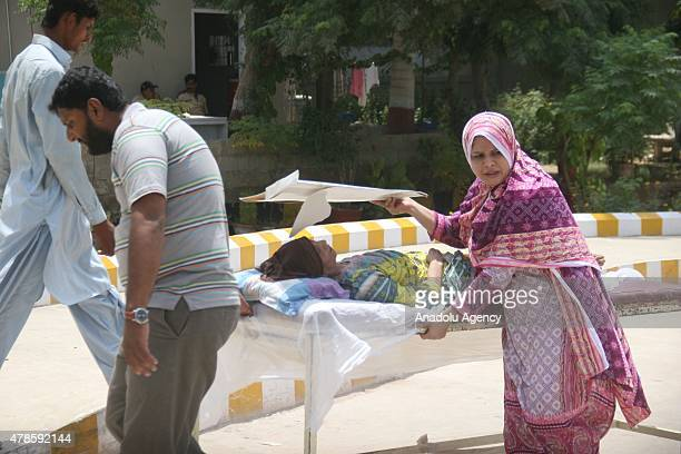 Pakistani relatives shift a heatstroke victim to a hospital in Karachi Pakistan on June 26 2015 More than 1000 people have been killed over seven...