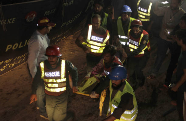 Pakistani rescue workers carry the injured woman after bomb blast in LahoreAugust 072017An explosion injured at least 34 people late August 7 in...