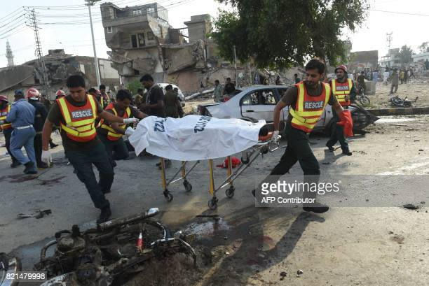 TOPSHOT Pakistani rescue workers move the body of a victim at the site of an explosion in Lahore on July 24 2017 An explosion killed at least 15...