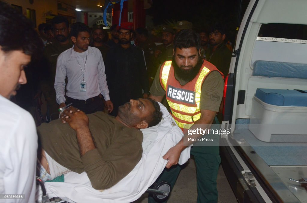 Pakistani rescue workers push a stretcher carrying an injured man to the hospital following the blast of a motorcycle bomb attack Nine people were...