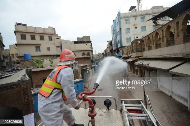 Pakistani rescue workers spray disinfectants in an effort to curb the spread of corona virus outbreak in Peshawar Pakistan The vast majority of...
