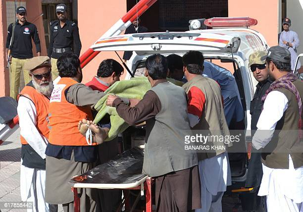 Pakistani rescue workers transport an attack victim in Quetta on October 25 after militants attacked a police academy Heavilyarmed Islamist militants...