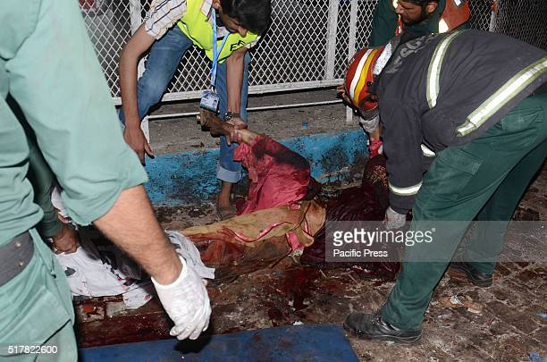 Pakistani rescuers and officials gather at a bomb blast site in Lahore At least 52 people were killed and dozens injured when an explosion ripped...