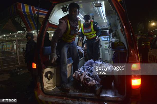 Pakistani rescuers carry a body in an ambulance from a bomb blast site in Lahore on March 27 2016 At least 25 people were killed and dozens injured...