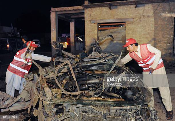 Pakistani rescuers collect evidence at the car bomb blast site in Peshawar on August 31 2012 A car bomb ripped through a market in the northwestern...