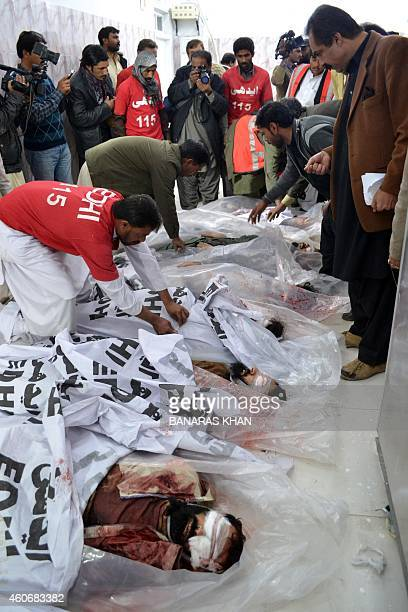 Pakistani rescuers cover the bodies of militants killed in operation at a hospital in Quetta on December 19 2014 At least seven militants were killed...