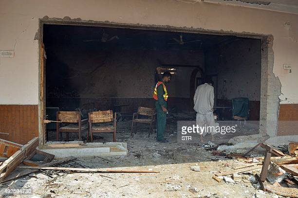 Pakistani rescuers inspect the site of a suspected suicide bomb attack in Taunsa town near Dera Ghazi Khan city in the southern part of Punjab...