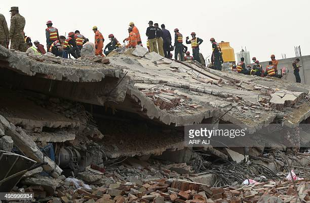 Pakistani rescuers search for victims in the rubble of a collapsed factory on the outskirts of Lahore on November 6 2015 Rescue crews resumed digging...