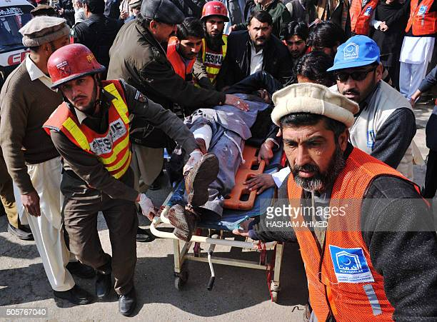 Pakistani rescuers shift an injured man to a hospital following an attack by gunmen in the Bacha Khan university in Charsadda about 50 kilometres...