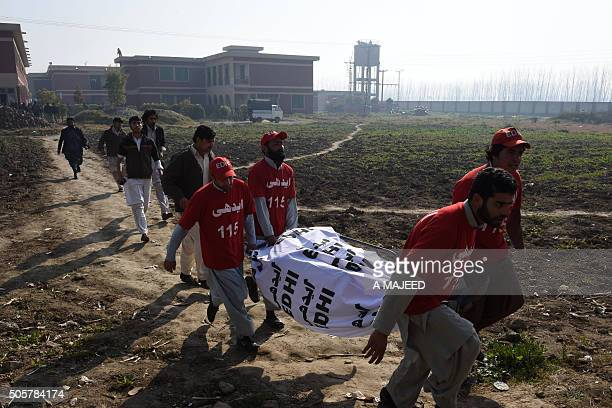 Pakistani rescuers shift an injured victim from the Bacha Khan university following an attack by militants in Charsadda about 50 kilometres from...