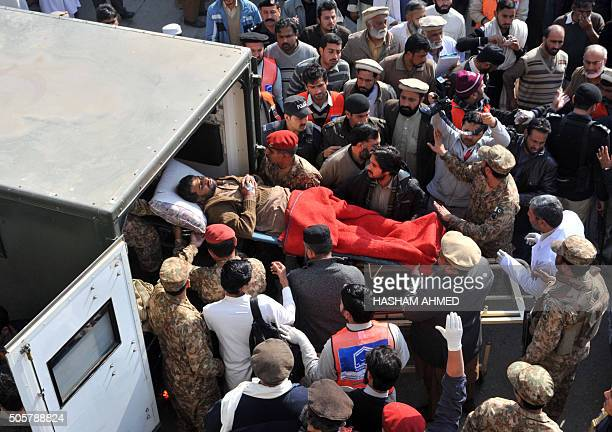 Pakistani rescuers shift an injured victim in an army ambulance from a hospital following an attack by militants in the Bacha Khan university in...