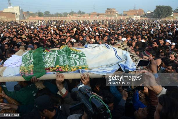 Pakistani residents carry the body of a girl during her funeral in Kasur in Punjab Province on January 10 following her rape and murder At least two...