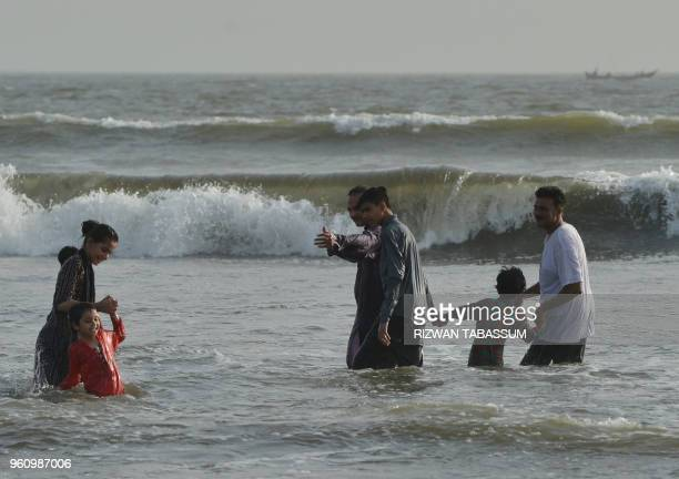 Pakistani residents cool off at Clifton beach during a heat wave in Karachi on May 21 2018 Residents of Pakistan's largest city Karachi were urged to...