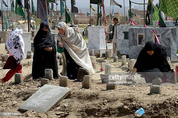 Pakistani residents from the Hazara community visit their relatives graves at a graveyard in Quetta on February 28 2013 Pakistan's Hazaras a...