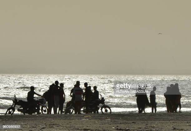 Pakistani residents gather at Clifton beach during a heat wave in Karachi on May 21 2018 Residents of Pakistan's largest city Karachi were urged to...