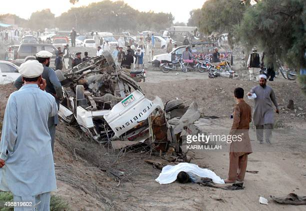Pakistani residents gather at the site after a bomb blast in Bannu on November 26 2015 At least two people were killed when a roadside bomb hit the...