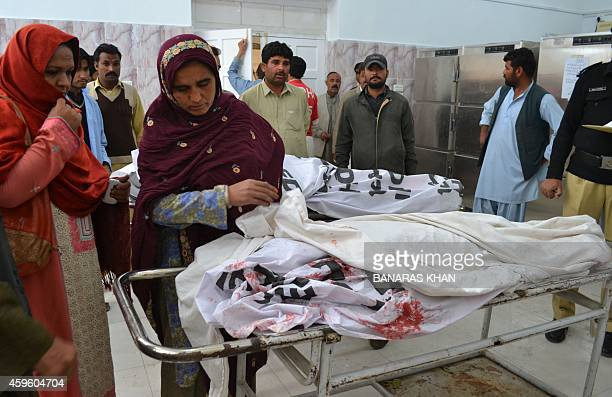 Pakistani residents identify the body of a polio health worker after an attack on the vehicle she was travelling in at a hospital in Quetta on...