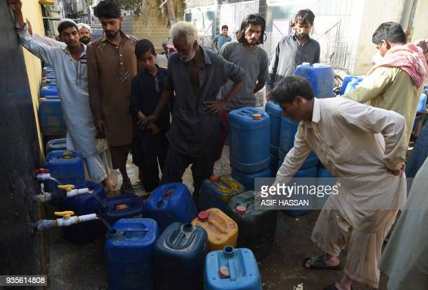 Pakistani residents wait for their turn outside a water filtration point in Karachi on March 21 ahead of World Water Day World Water Day is observed...