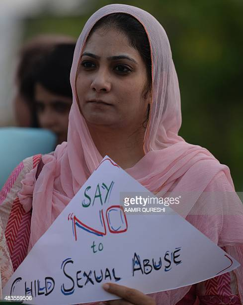 A Pakistani rights activist holds a placard during a protest against a child sex abuse scandal in Islamabad on August 10 2015 Pakistani police on...