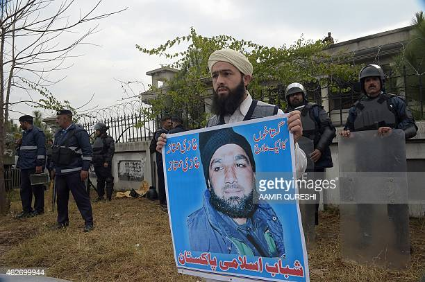 Pakistani riot policemen cordon off the high court building during a protest by Islamist and supporters of former police bodyguard Mumtaz Qadri in...