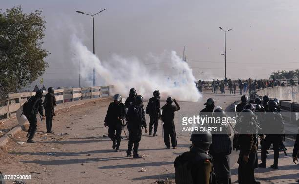 Pakistani riot policemen face off with protesters of the TehreekiLabaik Yah Rasool Allah Pakistan religious group during a clash in Islamabad on...