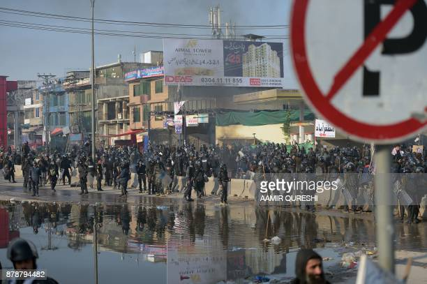 Pakistani riot policemen gather during a clash with protesters of the TehreekiLabaik Yah Rasool Allah Pakistan religious group during a clash in...