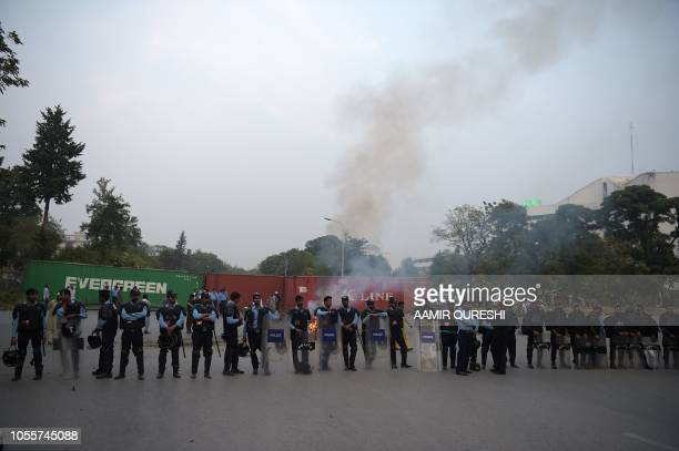 Pakistani riot policemen lineup on a blocked street leading to Pakistan's Supreme Court during a protest by Ahle Sunnat Wal Jamaat supporters a...