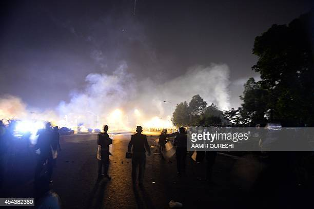 Pakistani riot policemen take position during clashes with opposition supporters near the prime minister's residence in Islamabad on August 30 2014...