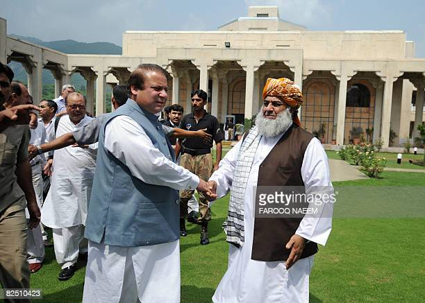 Pakistani ruling coalition leader and former premier Nawaz Sharif sees off Maulana FazalurRehman chief of Jamiat UlemaeIslam after the joint press...