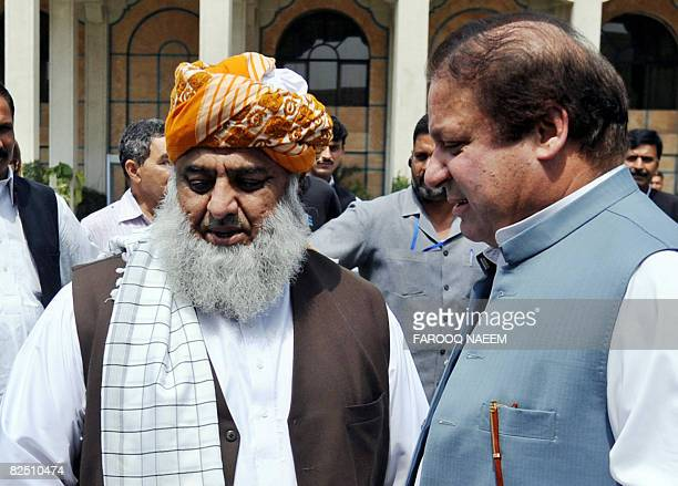 Pakistani ruling coalition leader former premier Nawaz Sharif chats with Maulana FazalurRehman chief of the Jamiat UlemaeIslam after the joint press...