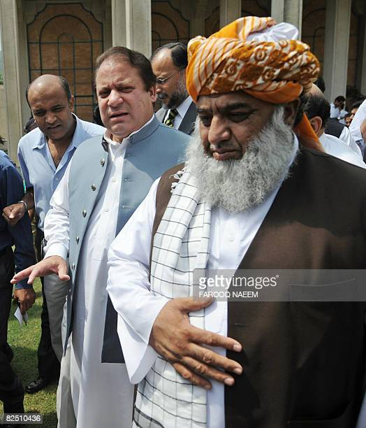 Pakistani ruling coalition leaders former premier Nawaz Sharif and Maulana FazalurRehman chief of Jamiat UlemaeIslam come out after the joint press...