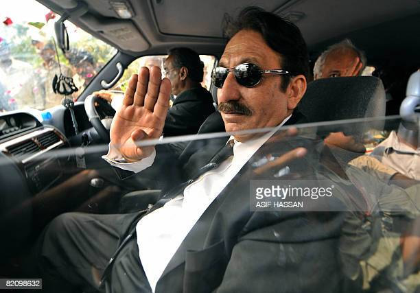 Pakistani sacked chief justice Iftikhar Muhammad Chaudhry waves to supporters upon his arrival in Karachi on July 29 2008 Chaudhry arrived on a two...