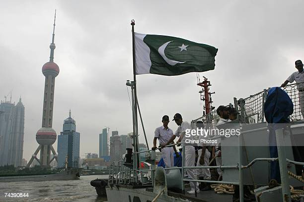 Pakistani sailors stand by onboard a depot ship that is accompaning the destroyer Babur June 4 2007 in Shanghai China Babur is in China for a fourday...