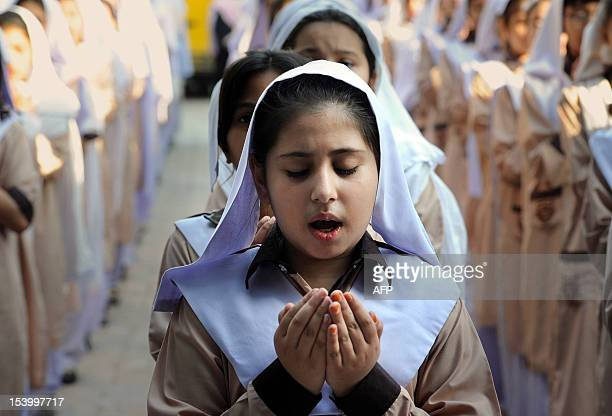 Pakistani school girls pray for the early recovery of child activist Malala Yousafzai who was shot in the head in a Taliban assassination attempt at...