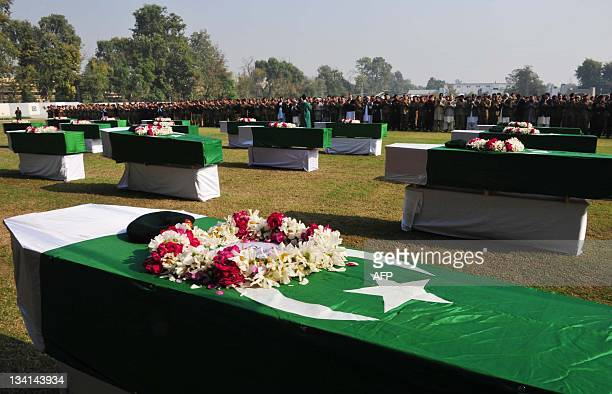 Pakistani security and government officials offer funeral prayers for the Pakistani soldiers who were killed in a NATO strike in Peshawar on November...