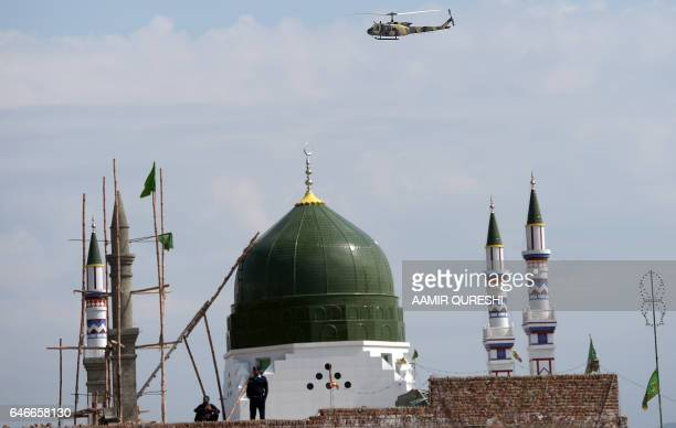 A Pakistani security force helicopter patrols over the tomb of Mumtaz Qadri who was hanged in February 2016 for the murder of a governor who...