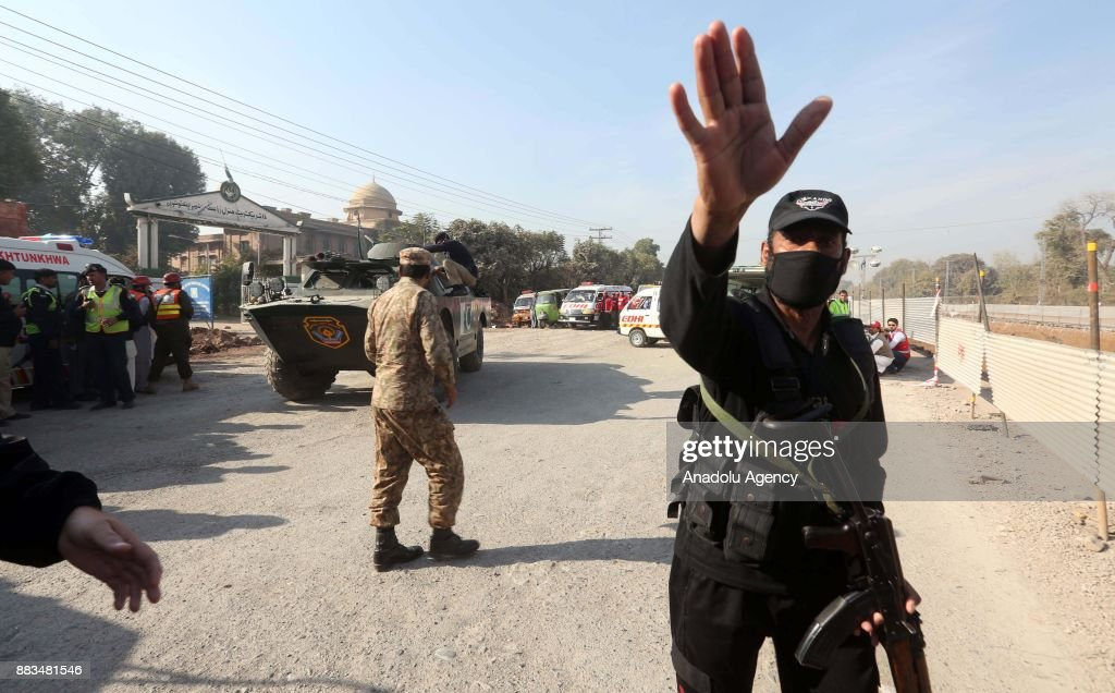 Pakistani security forces and rescuers are seen outside Peshawar Agricultural Training Institute which was attacked by Taliban militants, in the northwestern city of Peshawar, in Khyber Pakhtunkhwa province, Pakistan, on December 1, 2017. At least 12 people, including three suspected militants were killed and dozens others injured during an attack on a university hostel in Peshawar, the capital of northwestern Khyber Pakhtunkhawa province, according to army and police.