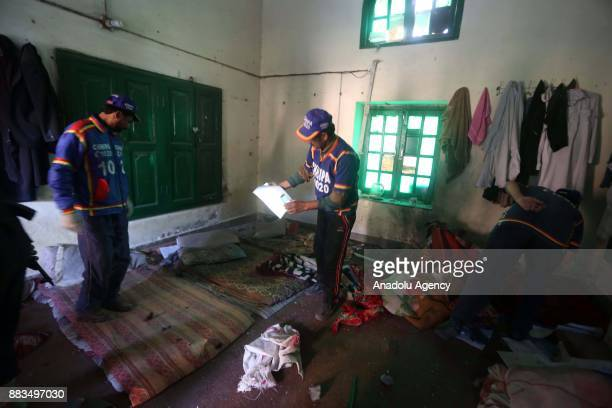 Pakistani security forces and rescuers at Peshawar Agricultural Training Institute which was attacked by Taliban militants in the northwestern city...