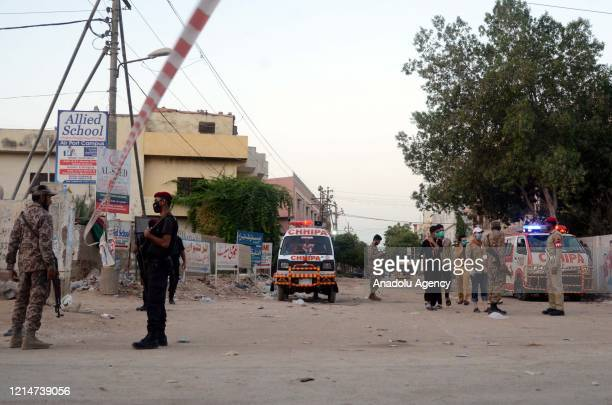 Pakistani security forces are seen at the site where Pakistan International Airlines flight PK-8303, traveling from northeastern Lahore, crashed into...