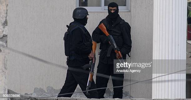 Pakistani security forces are seen on duty at the VaqarunNisa Girls College building after suspects tried to barged into the school following fire...