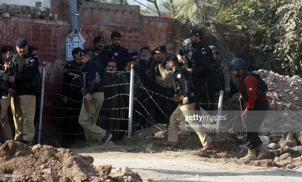 Pakistani security forces are seen outside Peshawar Agricultural Training Institute which was attacked by Taliban militants, in the northwestern city of Peshawar, in Khyber Pakhtunkhwa province, Pakistan, on December 1, 2017. At least 12 people, including three suspected militants were killed and dozens others injured during an attack on a university hostel in Peshawar, the capital of northwestern Khyber Pakhtunkhawa province, according to army and police.