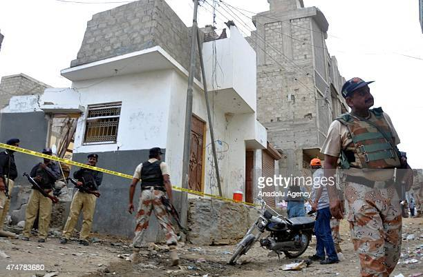 Pakistani security forces are seen outside the militants hideouts following raids in Karachi Pakistan on May 26 2015 Seven militants who were...
